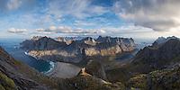 Panoramic view over Bunes beach and Vindstad from near Storskiva mountain peak, Moskenesøy, Lofoten Islands, Norway