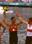 Atlanta, USA. left SUI M1X Gold Medalist, Xeno MULLER holds up  Bronze Medalist GER M1X, Thomas LANGE.  awards ceremony, 1996 Olympic Rowing Regatta Lake Lanier, Georgia [Mandatory Credit Peter Spurrier/ Intersport Images]
