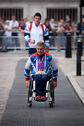 © Licensed to London News Pictures. 10/09/2012. LONDON, UK. Paralympic gold medal winning athlete David Weir arrives at a reception for British Olympic and Paralympic athletes held at the Queen Elizabeth II Conference Centre in London today (10/09/12). Photo credit: Matt Cetti-Roberts/LNP