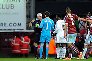 Match Referee Chris Foy ordering Goalkeeper Lukasz Fabianski of Swansea City off the field after he is sent off.  Barclays Premier league match, West Ham Utd v Swansea city at the Boleyn ground, Upton Park in London on Sunday 7th December 2014.<br /> pic by John Patrick Fletcher, Andrew Orchard sports photography.