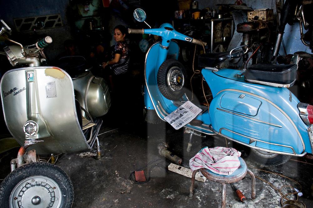Vintage blue vespa in a garage. Ho Chi Minh city, Vietnam, Asia