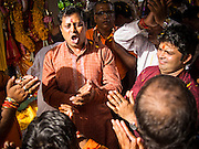 "15 SEPTEMBER 2013 - BANGKOK, THAILAND: Hindus in Bangkok sing and pray on the last day of Ganesha Chaturthi celebrations at Shiva Temple in Bangkok. Ganesha Chaturthi is the Hindu festival celebrated on the day of the re-birth of Lord Ganesha, the son of Shiva and Parvati. The festival, also known as Ganeshotsav (""Festival of Ganesha"") is observed in the Hindu calendar month of Bhaadrapada. The festival lasts for 10 days, ending on Anant Chaturdashi. Ganesha is a widely worshipped Hindu deity and is revered by many Thai Buddhists. Ganesha is widely revered as the remover of obstacles, the patron of arts and sciences and the deva of intellect and wisdom. The last day of the festival is marked by the immersion of the deity, which symbolizes the cycle of creation and dissolution in nature.  In Bangkok, the deity (statue) was submerged in the Chao Phraya River.         PHOTO BY JACK KURTZ"