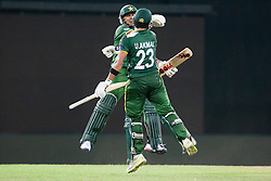 © Licensed to London News Pictures. 28/09/2012. Pakistani players Saeed Ajmal & Umar Akmal jump in celebration after beating South Africa in a close contest during the T20 Cricket World cup match between South Africa Vs Pakistan at the R.Premadasa Cricket Stadium,Colombo. Photo credit : Asanka Brendon Ratnayake/LNP