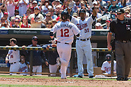 Chris Herrmann #12 of the Minnesota Twins is congratulated by Aaron Hicks #32 after scoring against the Seattle Mariners on June 2, 2013 at Target Field in Minneapolis, Minnesota.  The Twins defeated the Mariners 10 to 0.  Photo: Ben Krause