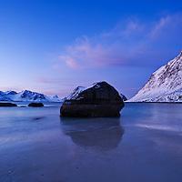 Large boulder on Haukland beach in winter, Vestvagøy, Lofoten islands, Norway