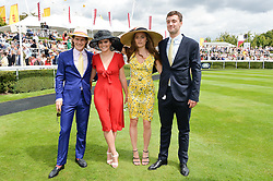 Left to right, LORD SETTRINGTON, POM OGILVY, LILY ATKINSON and MICHAEL ROY at the Qatar Goodwood Festival - Ladies Day held at Goodwood Racecourse, West Sussex on 30th July 2015.