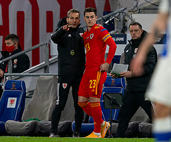 CARDIFF, WALES - Wednesday, November 18, 2020: Wales' substitute Tom Lawrence is given instructions by assistant coach Albert Stuivenberg during the UEFA Nations League Group Stage League B Group 4 match between Wales and Finland at the Cardiff City Stadium. Wales won 3-1 and finished top of Group 4, winning promotion to League A. (Pic by David Rawcliffe/Propaganda)
