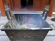 a incense offering at the Lama Temple in Beijing China