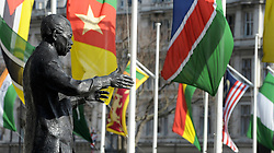 ©London News pictures. 14/03/11. The statues of Nelson Mandela overlooks the flags. Flags in London's Parliament Square today (Mon 14/03/11) celebrating Commonwealth Day. Picture Credit should read Stephen Simpson/LNP