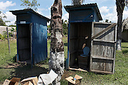 The old school lavatories in Puerto Firmeza which now has new eco onesAlianza Arkana promotes properly maintained composting latrines, also known as dry latrines, for managing human waste. The design is cheap and simple, using two large chambers that are used in succession to provide ample time between the uses of each side to ensure complete decomposition of the organic material. Chambers can even be built out of eco-bricks.
