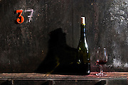 glass and bottle on a vat domaine du vissoux beaujolais burgundy france