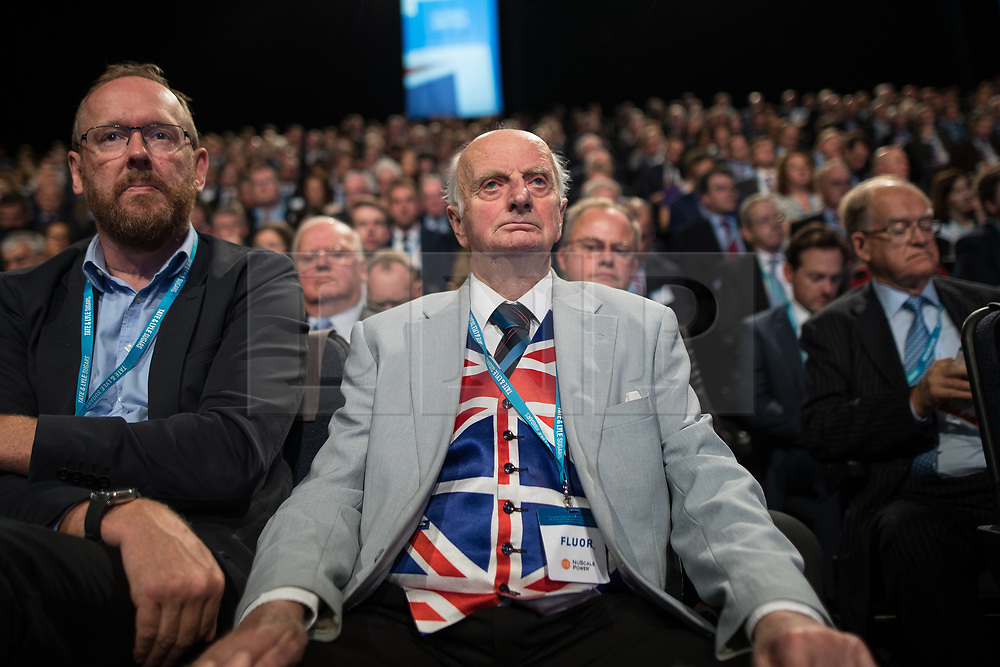 © Licensed to London News Pictures . 02/10/2017. Manchester, UK. A delegate listens to Chancellor Philip Hammond 's keynote speech during the second day of the Conservative Party Conference at the Manchester Central Convention Centre . Photo credit: Joel Goodman/LNP