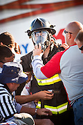 A firefighter is helped by officials after finishing the firefighting obstacle course d wearing full firefighting gear and working against the clock during the international finals of the Firefighter Combat Challenge on November 18, 2011 in Myrtle Beach, South Carolina.