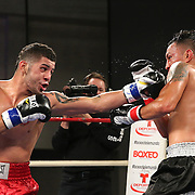 """Emanuel  DeJesus (red shorts) fights against Juan Aguirre during a """"Boxeo Telemundo""""  boxing match at the Kissimmee Civic Center on Friday, July 18, 2014 in Kissimmee, Florida. DeJesus won the bout. (AP Photo/Alex Menendez)"""