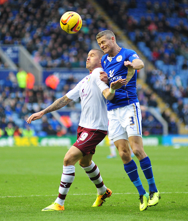 Leicester City's Paul Konchesky clears the ball under pressure from Burnley's Michael Kightly, who's appeals for a penalty were turned down<br /> <br /> Photo by Chris Vaughan/CameraSport<br /> <br /> Football - The Football League Sky Bet Championship - Leicester City v Burnley - Saturday 14th December 2013 - King Power Stadium - Leicester<br /> <br /> © CameraSport - 43 Linden Ave. Countesthorpe. Leicester. England. LE8 5PG - Tel: +44 (0) 116 277 4147 - admin@camerasport.com - www.camerasport.com