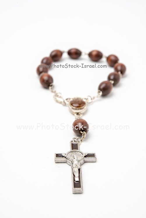 Christian souvenirs from the Holy Land Olive wood Rosary and crucifix on white background