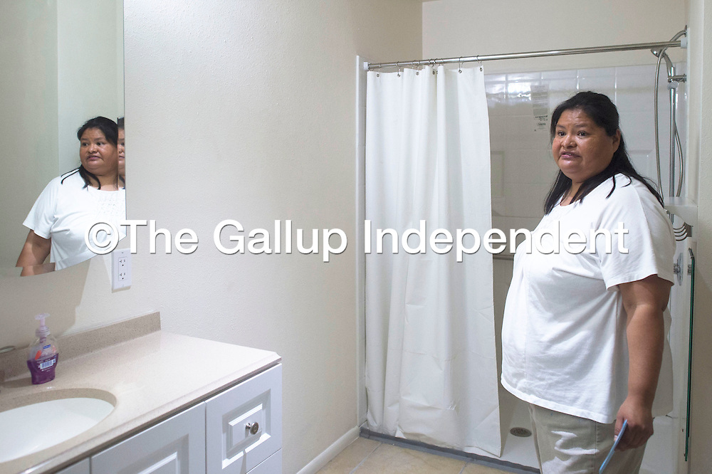 082715      Cayla Nimmo<br /> <br /> April Shorty gives a tour of her new house built by Habitat for Humanity during the dedication in Gallup Thursday. Shorty's daughter Ashley is is special needs so the house was built to comply with Americans with Disabilities regulations.