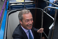"""Smith Square, Westminster, London, June 16th 2016. UKIP leader Nigel Farage launches his """"biggest ever"""" advertising campaign as Leave and Remain enter their last week of campaigning before the EU referendum on June 23rd. PICTURED: Nigel Farage is all smiles as he boards the UKIP battle bus."""