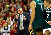 UW-Green Bay coach Linc Darner gestures to his players during the first half of the UW-Green Bay Men's Basketball game versus University of Wisconsin at the Kohl Center, Wednesday, December 14, 2016.