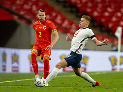 LONDON, ENGLAND - Thursday, October 8, 2020: Wales' Chris Gunter (L) and England's Harvey Barnes during the International Friendly match between England and Wales at Wembley Stadium. The game was played behind closed doors due to the UK Government's social distancing laws prohibiting supporters from attending events inside stadiums as a result of the Coronavirus Pandemic. England won 3-0. (Pic by David Rawcliffe/Propaganda)