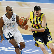 Efes Pilsen's Erwin DUDLEY (L) and Fenerbahce Ulker's Darjus LAVRINOVIC (R) during their Turkish Basketball league derby match Efes Pilsen between Fenerbahce Ulker at the Sinan Erdem Arena in Istanbul Turkey on Sunday 24 April 2011. Photo by TURKPIX