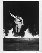 a man jumping over a burning boats in cambridge 1984       ONE TIME USE ONLY - DO NOT ARCHIVE  © Copyright Photograph by Dafydd Jones 66 Stockwell Park Rd. London SW9 0DA Tel 020 7733 0108 www.dafjones.com