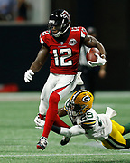 Mohamed Sanu of the Atlanta Falcons runs with the ball after a catch during the game against the Green Bay Packers at Mercedes Benz Stadium on Sep 17, 2017.