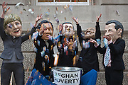 Protestors wearing masks and dressed as the big world leaders 'throwing money at poverty in Afghanistan' to show how most of it isn't getting to where it is supposed to be during an event in London, United Kingdom.  L-R  Angela Merkel (Germany), Yukio Hatoyama (Japan), Barack Obama (USA), Gordon Brown (UK), Nicolas Sarkozy (France).
