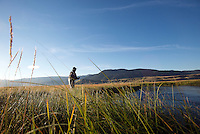 Reed Kaestner casts for cutthroat trout on Flat Creek on Saturday, the opening day of fishing on the picturesque waterway that winds through the National Elk Refuge.