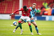 Max Melbourne of Walsall   and Forest Green Rovers Scott Wagstaff(21) battles for possession during the EFL Sky Bet League 2 match between Walsall and Forest Green Rovers at the Banks's Stadium, Walsall, England on 10 April 2021.