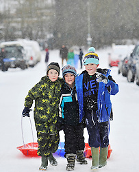© Licensed to London News Pictures. 20 January 2013. Chipping Norton, Oxfordshire. Left to right. Kyle Hurley (8), Louis Akers (8) and Jonathen Eaketts-Rogers (9)Probably the best Street in England for sledging? Residents of The Leys in Chipping Norton have made a super sledging run in the road. The local children even prevented council workers from salting the road by sitting down across the road to block the gritters. Everyone who live in the Leys seems to love the sledging run and have even joked that they want to apply for a ski lift to be installed for future years fun.. Photo credit : MarkHemsworth/LNP
