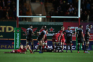 Scarlets players celebrate as Toulon players look dejected at the end of the game. EPCR European Champions cup match, Scarlets v RC Toulon at the Parc y Scarlets in Llanelli, West Wales on Saturday 20th January 2018. <br /> pic by  Andrew Orchard, Andrew Orchard sports photography.