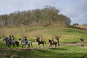 Members of Heythrop Hunt ride across Oxfordshire countryside, United Kingdom