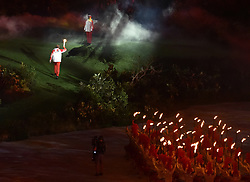 JAKARTA, Aug. 18, 2018  A torchbearer enters into the Gelora Bung Karno (GBK) Main Stadium at the opening ceremony of the 18th Asian Games in Jakarta, Indonesia, Aug. 18, 2018. (Credit Image: © Li He/Xinhua via ZUMA Wire)