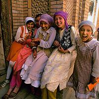 CHINA,  Xinjiang.  Uygar girls giggle over encounter with photographer in Kashgar.