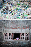 Thousands of plastic bottles stored on the roof of a house in the Garbage City.