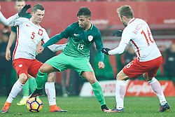 Wroclaw, Poland - 2016 November 14: Andraz Sporar of Slovenia fights for the ball with (L) Krzysztof Maczynski of Poland and Jakub Blaszczykowski of Poland during Poland v Slovenia - International Friendly Soccer Match at Municipal Stadium on November 14, 2016 in Wroclaw, Poland.<br /> <br /> Adam Nurkiewicz declares that he has no rights to the image of people at the photographs of his authorship.<br /> <br /> Picture also available in RAW (NEF) or TIFF format on special request.<br /> <br /> Any editorial, commercial or promotional use requires written permission from the author of image.<br /> <br /> Mandatory credit:<br /> Photo by © Adam Nurkiewicz / Mediasport