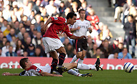 Photo: Daniel Hambury.<br />Fulham v Manchester United. The Barclays Premiership. 01/10/2005.<br />Manchester Utd's England hopeful, Keiran Richardson evades the tackle of Fulham's Brian McBride.