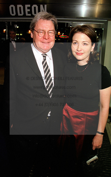 Film director ALAN PARKER and his partner LISA, at a film premier in London on 11th January 2000.OAB 44