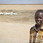 Hardly a drop of water left in the waterhole, but still smiling. This image sums up the remarkable hope and fortitude I see in children. Young goatherd near Garissa, North Eastern Kenya.