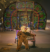 A man dressed up as a monkey during the street celebration of Diwali, the festival of lights.