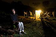 Juiz de Fora_MG, Brasil...Mulher sentada proxima a uma casa beneficiada pela eletrificacao rual  na zona rural de Juiz de Fora...A woman sitting next to a house as received rural electrification in the rural area in Juiz de Fora...Foto: LEO DRUMOND / NITRO.