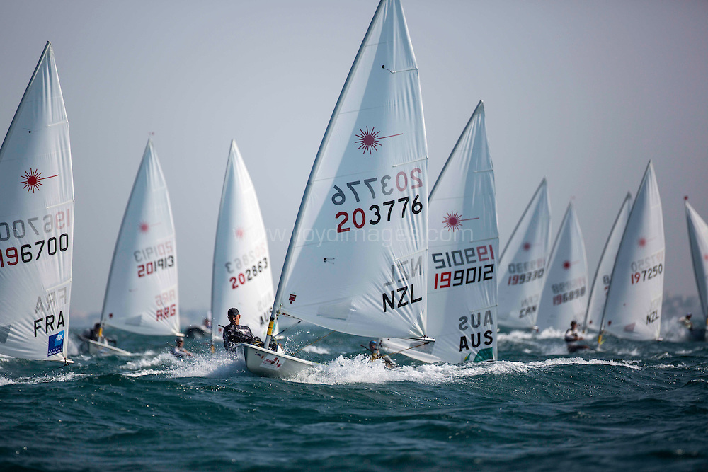 Laser World Championships 2013. Mussanah. Oman. Day 1 of racing, Andrew Maloney (NZL)<br /> Credit: Lloyd Images