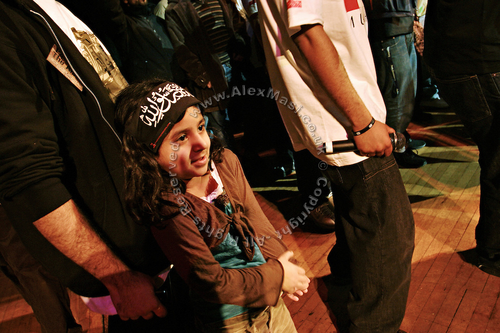Young spectators are taking part to the final moments on stage of the 'Palestine - The Album', a music collection recorded by many different artists in the Islamic Hip Hop scene in London, England, on Saturday, Jan. 6, 2007.  Islamic Hip Hop artists like the duo 'Blind Alphabetz', from London, feel more than ever the need to say what they think aloud. In the music industry the backlash of a disputable Western foreign policy towards Islamic countries and its people is strong. The number of artists in the European Union and the US taking this into consideration and addressing the current social and political problems within their lyrics is growing rapidly and fostering awareness for Muslim and others alike.