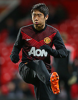 Manchester United's Shinji Kagawa warms up ahead of the Barclays Premier League match at Old Trafford, Manchester. PRESS ASSOCIATION Photo. Picture date: Tuesday January 28, 2014. See PA story SOCCER Man Utd. Photo credit should read: Dave Thompson/PA Wire. RESTRICTIONS: Editorial use only. Maximum 45 images during a match. No video emulation or promotion as 'live'. No use in games, competitions, merchandise, betting or single club/player services. No use with unofficial audio, video, data, fixtures or club/league logos.