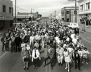 """April 29, 1989-Guadalupe, CA: On Saturday April 29, 1989 The Guadalupe Mural Project attempted to take a photograph of the entire population of Guadalupe, California.  All residents of Guadalupe, young and old were invited to gather for the """"Big Picture"""".  """"The Big Picture"""".  Guadalupe, California was taken in conjunction with Judy Baca and the """"Guadalupe Mural Project"""" sponsored by Santa Barbara County Arts In Public Places Program, El Comite Civco Mexicano, Santa Barbara County Parks Dept.,City of Guadalupe, Guadalupe Chamber of Commerce. Many Thanks to Joe Rodriguez, the Guadalupe Mural Project Team and the people of Guadalupe, CA.  Photo by Rod Rolle"""
