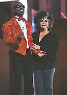 Elizabeth Taylor and Stevie Wonder at the Martin Luther King Jr Gala at the Kennedy Center for the Performing Arts in February 1986..Photograph by Dennis Brack bb32