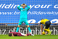 GOAL 2-3 Andy Irving (#19) of Heart of Midlothian FC sinks to the turf with his head in his hands after scoring an own goal during the SPFL Championship match between Heart of Midlothian and Queen of the South at Tynecastle Park, Edinburgh, Scotland on 27 March 2021.