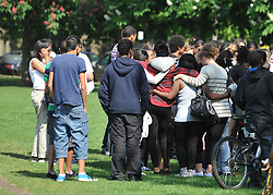 © licensed to London News Pictures. LONDON UK. 25/04/11.Friends and family gather at a memorial service in a park in Chiswick, London, today (25 April 2011) to remember Isobel Reilly who died after a party in the early hours of Saturday morning. Photo credit should read Stephen Simpson/LNP