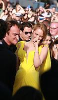 Quentin Tarantino John Travolta and Uma Thurman at Sils Maria gala screening red carpet at the 67th Cannes Film Festival France. Friday 23rd May 2014 in Cannes Film Festival, France.